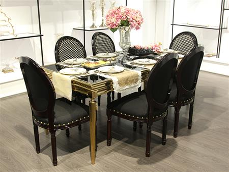 Glass black dining table with gold detail